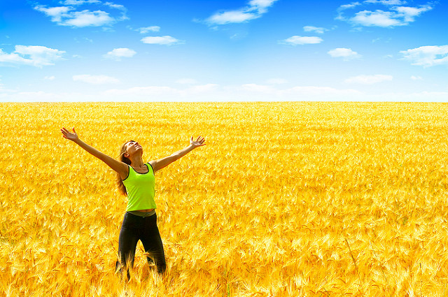 back pain, pain, low back - person with outstretched arms, in a golden field