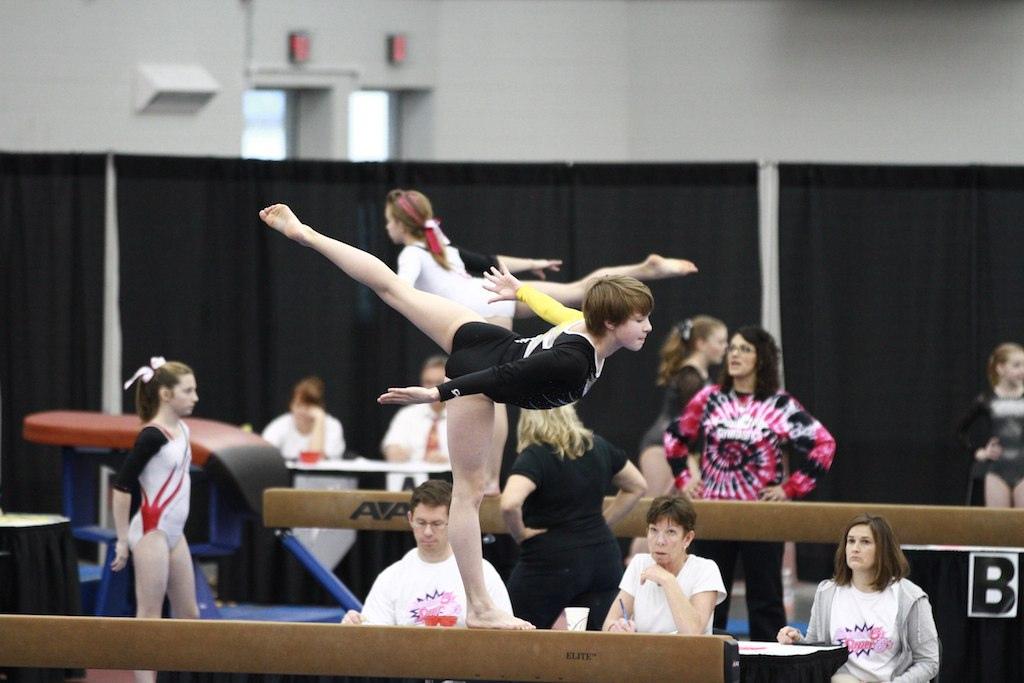 Early Sports Specialization gymnastics phoenix - people performing gymnastics