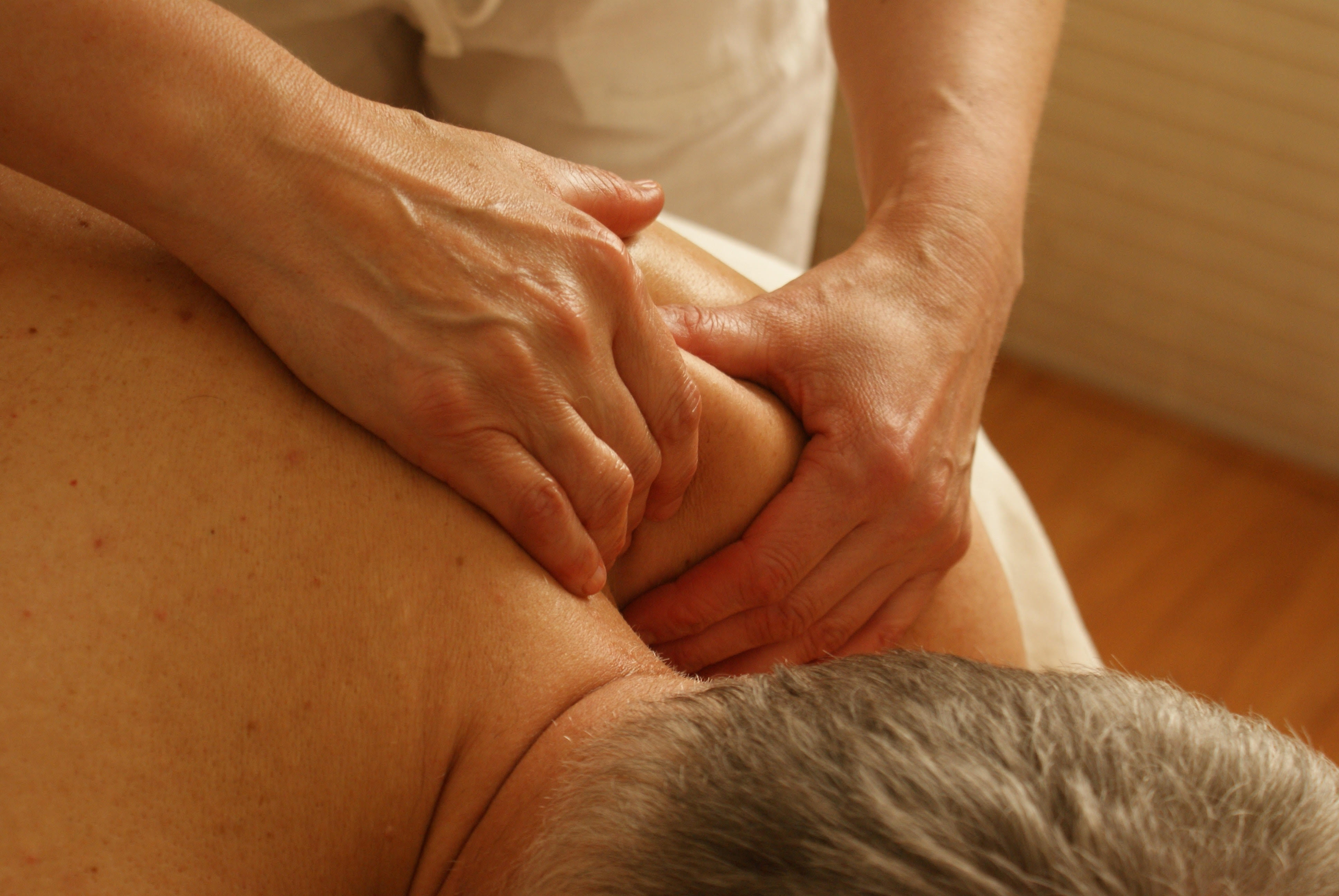 Manual Therapy in Phoenix & Mesa - person massaging back-shoulder