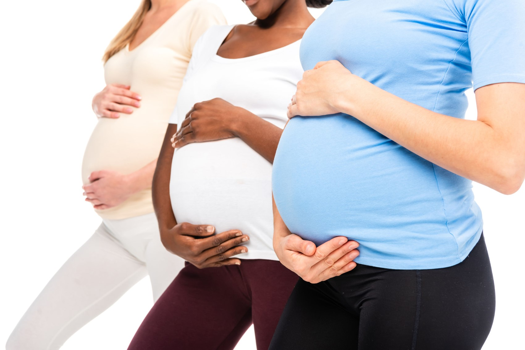 cropped view of three pregnant women holding hands on bellies - Aches and Pains in Pregnancy